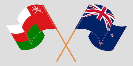Crossed and waving flags of Oman and New Zealand