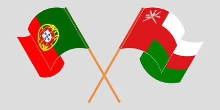 Crossed and waving flags of Oman and Portugal