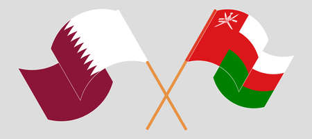 Crossed flags of Oman and Qatar