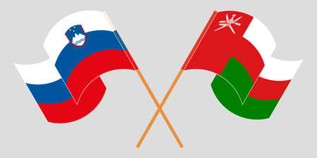 Crossed and waving flags of Oman and Slovenia