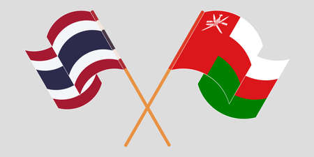 Crossed and waving flags of Oman and Thailand