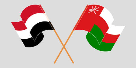 Crossed and waving flags of Oman and Yemen