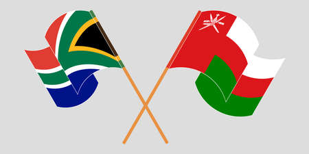Crossed and waving flags of Oman and the RSA