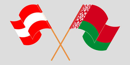 Crossed and waving flags of Belarus and Austria