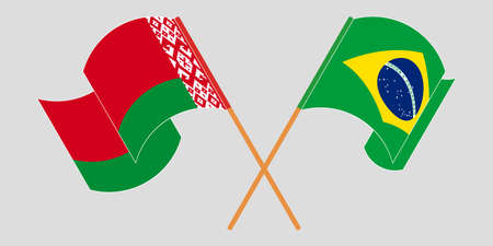 Crossed and waving flags of Belarus and Brazil