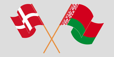 Crossed and waving flags of Belarus and Denmark