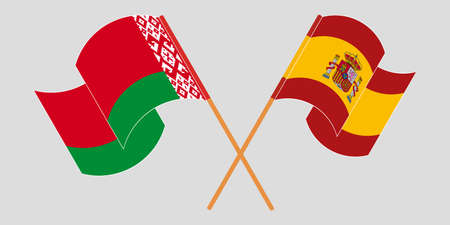 Crossed and waving flags of Belarus and Spain