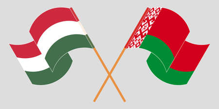 Crossed and waving flags of Belarus and Hungary 向量圖像