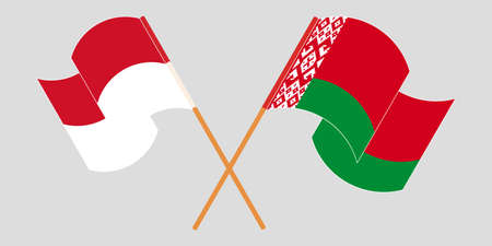 Crossed and waving flags of Belarus and Indonesia