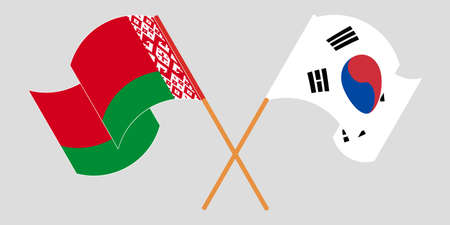 Crossed and waving flags of Belarus and South Korea