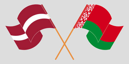 Crossed and waving flags of Belarus and Latvia