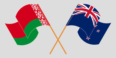 Crossed and waving flags of Belarus and New Zealand