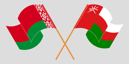 Crossed and waving flags of Belarus and Oman