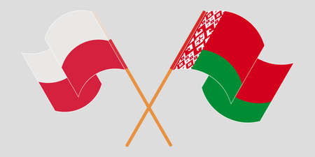 Crossed and waving flags of Belarus and Poland