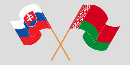 Crossed and waving flags of Belarus and Slovakia