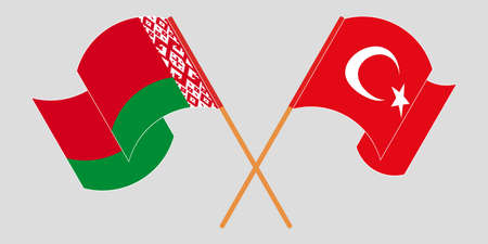 Crossed and waving flags of Belarus and Turkey