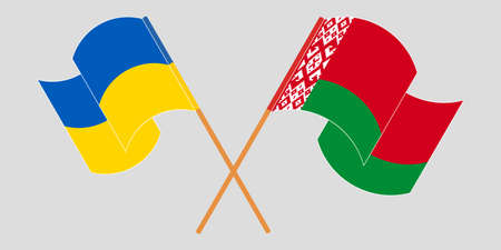 Crossed and waving flags of Belarus and Ukraine
