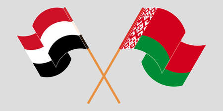 Crossed and waving flags of Belarus and Yemen