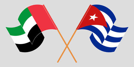 Crossed and waving flags of Cuba and the United Arab Emirates