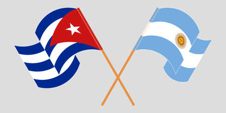 Crossed and waving flags of Cuba and Argentina