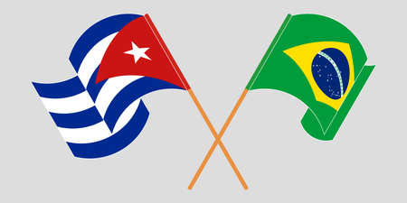 Crossed and waving flags of Cuba and Brazil