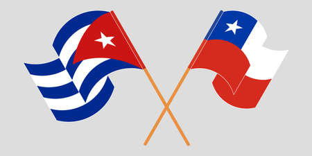 Crossed and waving flags of Cuba and Chile