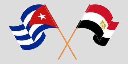 Crossed and waving flags of Cuba and Egypt