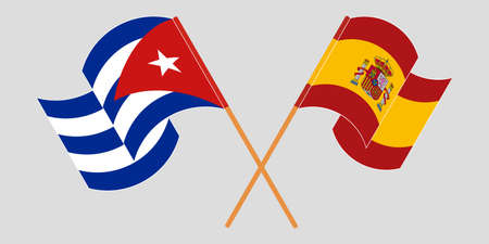 Crossed and waving flags of Cuba and Spain