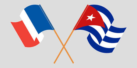 Crossed and waving flags of Cuba and France