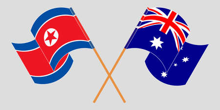 Crossed and waving flags of North Korea and Australia