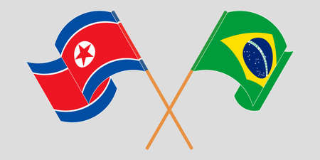 Crossed and waving flags of North Korea and Brazil