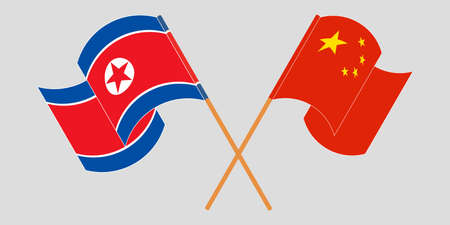 Crossed and waving flags of North Korea and China
