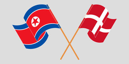 Crossed and waving flags of North Korea and Denmark