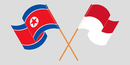 Crossed and waving flags of North Korea and Indonesia