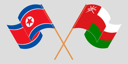 Crossed and waving flags of North Korea and Oman