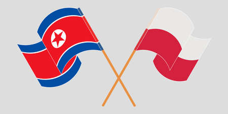Crossed and waving flags of North Korea and Poland