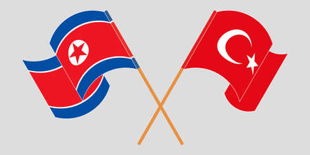 Crossed and waving flags of North Korea and Turkey
