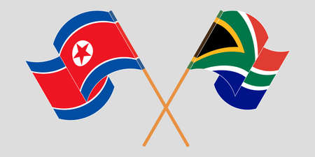 Crossed and waving flags of North Korea and Republic of South Africa