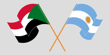 Crossed and waving flags of Sudan and Argentina