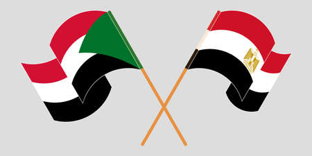 Crossed and waving flags of Sudan and Egypt