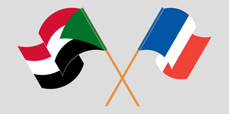 Crossed and waving flags of Sudan and France