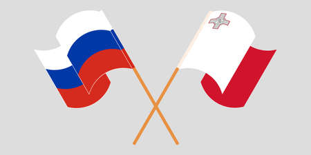 Crossed and waving flags of Malta and Russia