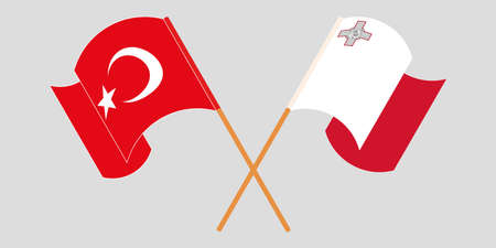 Crossed and waving flags of Malta and Turkey