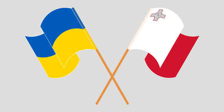 Crossed and waving flags of Malta and Ukraine