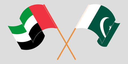Crossed and waving flags of Pakistan and the United Arab Emirates