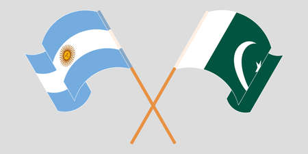 Crossed and waving flags of Pakistan and Argentina