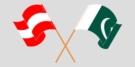 Crossed and waving flags of Pakistan and Austria