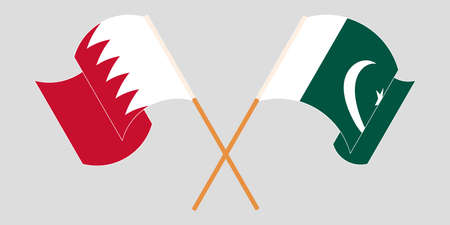 Crossed and waving flags of Pakistan and Bahrain