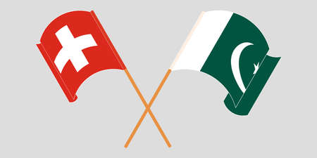 Crossed and waving flags of Pakistan and Switzerland