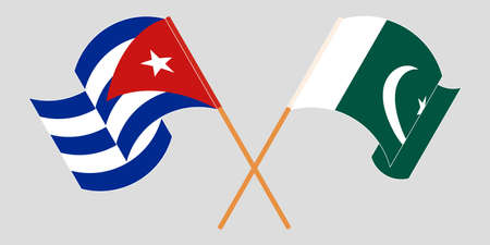 Crossed and waving flags of Pakistan and Cuba